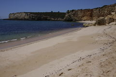 Portugal empty sandy beach and cliffs, calm sea Royalty Free Stock Images