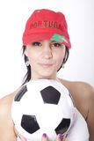 Portugal fan. Girl wearing a Portugal hat and holding football Royalty Free Stock Image