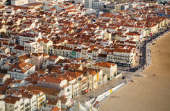 Portugal Fishing Village Town of Nazare. The beach and boardwalk of the picturesque Portugese village of Nazar Stock Images