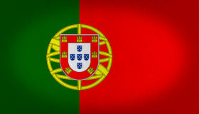 Portugal flag. With a graphic shield at the left side, green and red background in two vertical lines, fabric texture background Royalty Free Stock Photos