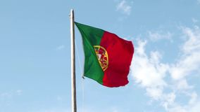 Portugal flag. Waving in the wind against a clear sky stock footage