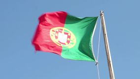 Portugal Flag. Waving in the wind against a clear sky stock video