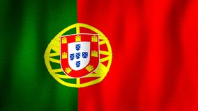 Portugal flag waving in the wind. Closeup of realistic Portuguese flag with highly detailed fabric texture