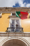 Portugal flag waving on the wind in front an administrative buil Stock Images