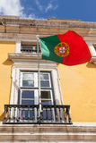 Portugal flag waving on the wind in front an administrative buil Stock Photography