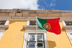 Portugal flag waving on the wind in front an administrative buil Stock Image