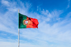 Portugal flag waving on the wind over a cloudy sky Royalty Free Stock Photo