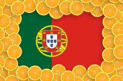 Portugal flagga i ny citrusfruktskivaram royaltyfria bilder
