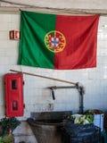 Portugal flagga på den vita tegelplattaväggen inom den antika Bolhao marknaden: i Porto Portugal Arkivfoton