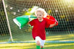 Portugal football fan kids. Children play soccer. royalty free stock photos