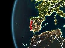 Portugal från utrymme på natten Arkivfoton