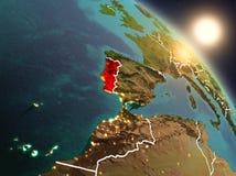 Portugal från utrymme under soluppgång Arkivbild