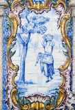 Portugal, historical Azulejo ceramic tiles. Portugal, Douro Region,  Important historical blue and white ceramic Azulejo tiles depicting rural scenes - women Royalty Free Stock Photos