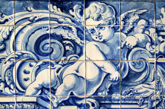 Portugal, historical Azulejo ceramic tiles. Portugal, Lisbon, Important historical blue and white ceramic Azulejo wall tiles depicting an angel Royalty Free Stock Images
