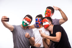Portugal, Hungary, Iceland, Austria take selfie photo on white background. Group of football fans support their national team: Portugal, Hungary, Iceland Stock Photos
