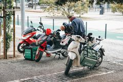 Portugal, Lisbon 29 april 2018: workers Uber Eats delivery scooter with pannier Royalty Free Stock Photos