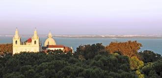 Portugal, Lisbon: Church and Taje River at dusk Royalty Free Stock Image