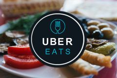 Portugal, Lisbon, June 16, 2018: the UBER eats logo. A popular firm for the delivery of food at home and in offices. Express meal delivery Stock Photo