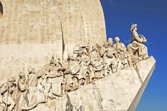 Portugal, Lisbon: Monument to the discoveries. Portugal, Lisbon: monument to the maritime discoveries; stone carved with the main figures of this historical Royalty Free Stock Images