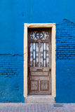Portugal, Lisbon, old door on the blue wall Royalty Free Stock Images