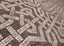 Portugal. Lisbon. Typical portuguese cobblestone pavement. In Se Stock Photography