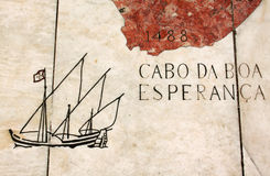Portugal, map of Portuguese voyages of discovery in marble. Portugal, Lisbon, map scribed in marble depicting a caravela sailing ship passing the Cape of Good Royalty Free Stock Images