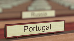 Portugal name sign among different countries plaques at international organization. 3D rendering Royalty Free Stock Images