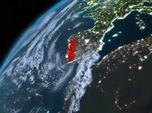 Portugal på planetjord i utrymme på natten Arkivfoton