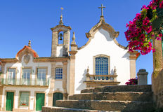 Portugal, Ponte da barca, ancient monument, Church. Portugal, Ponte da barca, ancient monument, blue sky ; pink flowers and white church stock photo