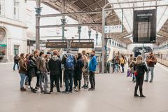 A group of people are standing on a platform at the railway station in Porto royalty free stock photo