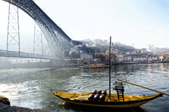 Portugal, Porto - OCTOBER 06, 2016: old Rabelo boats with wine barrels  have traditionally been used for the transport of port on Royalty Free Stock Photography
