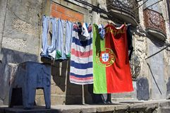 Portuguese flag on towel drying on clothes line. Portugal, Porto province, region Costa Verde, city Porto: In the old district, residential area, Ribeira hangs Royalty Free Stock Photos