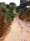 Portugal. Sandy path between cliffs Stock Photos