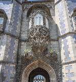Portugal , Sintra . Castle Pena, Triton  over the lancet arch. Leading to the courtyard of the castle supports the balcony. The figure is decorated with real Royalty Free Stock Image