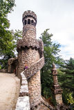 Portugal , Sintra . Palace Regaleira is typical Gothic architectural elements , such as turrets, gargoyles, and a tower in the sha. Pe of an octagon Stock Image