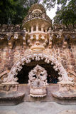 Portugal , Sintra . Palace Regaleira is typical Gothic architectural elements , such as turrets, gargoyles, and a tower in the sha. Pe of an octagon Stock Images