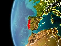 Portugal from space in evening. Evening over Portugal as seen from space on planet Earth with visible border lines and city lights. 3D illustration. Elements of Royalty Free Stock Image