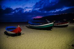 Free Portugal, Twilight Over Nazare Beach, Red Wooden Boat Stock Image - 169326901