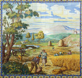 Portugal. Typical historical ceramic `azulejo` tiles depicting farm workers harvesting crops. Royalty Free Stock Photo