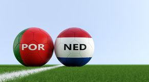 Portugal vs. Netherlands Soccer Match - Soccer balls in Portugal and Netherlands national colors on a soccer field. Royalty Free Stock Image