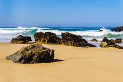 Portugals sandy beach on rocky Atlantic coast. Adraga beach royalty free stock photography