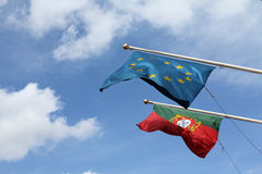 Portugese and EU flags. Portuguese and eu flag during the day Stock Photography