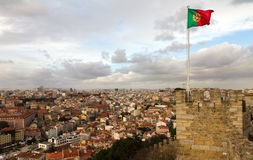 Portugese flag on top of the castle Royalty Free Stock Photo