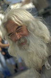 Portugese man with a beard. Alentejo, Portugal, 26-September-2007: An old man with shiny long hair and a beard smiling for the picture in Alentejo Royalty Free Stock Photography