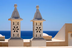 Portugese Rooftop Chimneys. Typical seaside portugese algarve rooftop chimneys on a beautiful sunny day Stock Images