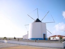 Portugese windmill. Traditional windmill at the Portugese seaside near Faro Royalty Free Stock Images