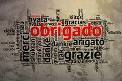 Portugiese Obrigado, offene Wort-Wolke, Dank, Schmutz-Hintergrund Stockfoto