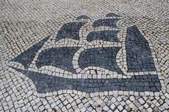PortugisCalcada för traditionell stil trottoar för fot- område i Macao, Kina Arkivbild