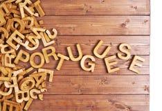Português da palavra feito com letras de madeira Fotos de Stock