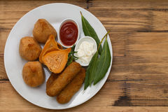 Portuguese appetizers with sauces on white plate Royalty Free Stock Photo